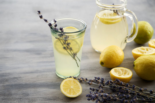 Lemonade with lemons and lavender on gray  shabby table