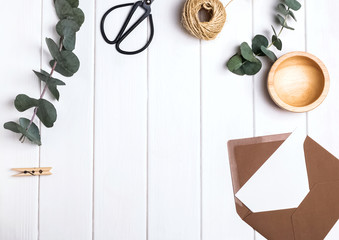 Simple objects and eucalyptus branches on the white table