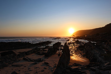Beautiful sunset over the rocky coastline of the Tsitsikamma National Park - South Africa