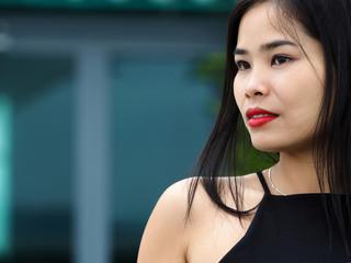 Beautiful young brunette vietnam girl wearing black dress