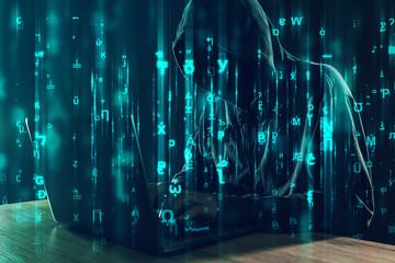 Computer hacker working on laptop, programming bugs and viruses