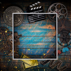 Cinema concept of vintage film reels, clapperboard and other tools.