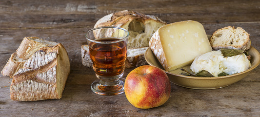 traditional french food in country/different cheeses, bread and wine