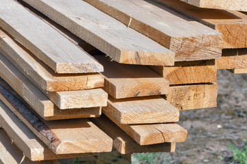 Ends of rough pine boards in the outdoor stack