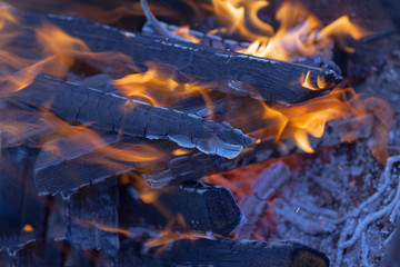 The hot embers of the fire with sparks and ashes