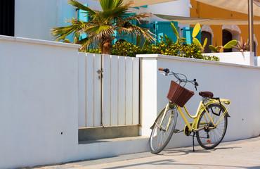 Retro bike near colorful house entrance at Patacona beach. Valencia, Spain.