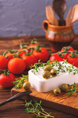 Feta with thyme, cherry tomatoes and green olives