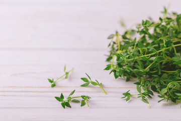 Bunch of fresh organic thyme on wooden background