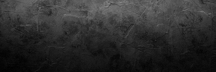 Black empty concrete stone texture. Slate background. Long banner format. Wall mural
