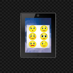 Tablet black on a white background. On the screen the image of a round yellow emoticons. Set of emoticons with different facial expressions.