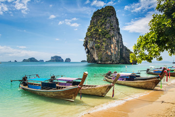 Amazing view of beautiful beach with longtale boats. Location: Railay beach, Krabi, Thailand, Andaman Sea. Artistic picture. Beauty world. Wall mural