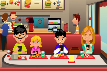 Family Eating Out in the Restaurant