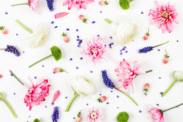 Flowers composition. Pattern made of ranunculus, chrysanthemum and other flowers on white background. Flat lay, top view.