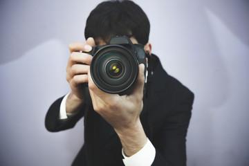 Photographer shooting with digital camera