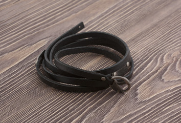 Black bracelet on wooden boards