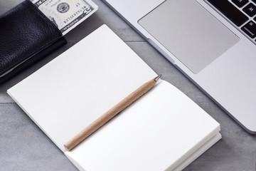 Open notebook, laptop, wallet. Saving, earning, making money, budget planning concept. Copyspace
