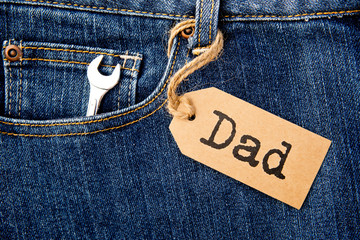 Dad tag with shifter tool on blue denim