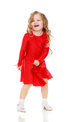 Girl dancing in a bright red dress.