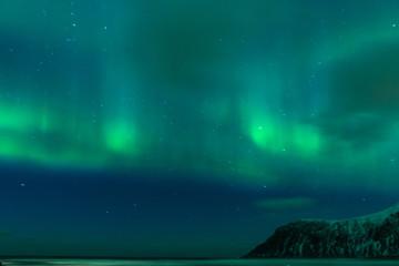 Picturesque Unique Northern Lights Aurora Borealis Over Lofoten Islands in Nothern Part of Norway.