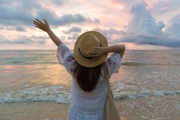 Tuinposter Art Studio Woman photographer is enjoy travel on the beach.