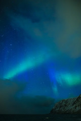 Amazing and Unique Nothern Lights Aurora Borealis Over Lofoten Islands in Norway, Over the Polar Circle.