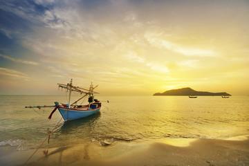 Fisherman boat at sunrise