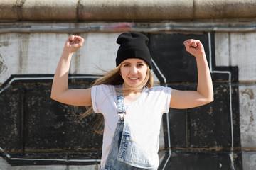 Young woman break dancing on wall background.  Hip-Hop Dancer.