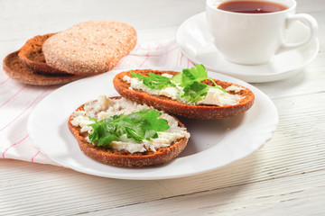 Rye bread with soft cheese and greens