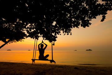 Beautiful woman on swing Thailand