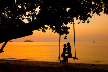 Beautiful couple on swing Thailand