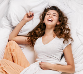 Laughing woman in bed
