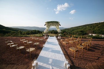 Wedding ceremony at nature sunset