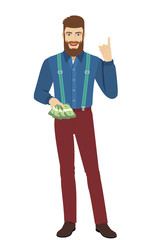 Hipster with cash money pointing up