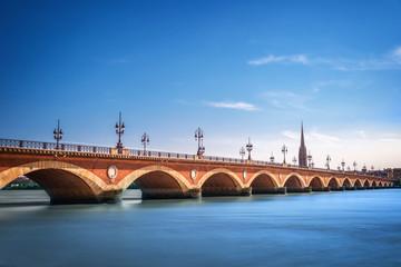 Photo sur Aluminium Pont Pont de Pierre bridge with St Michel cathedral, Bordeaux, France