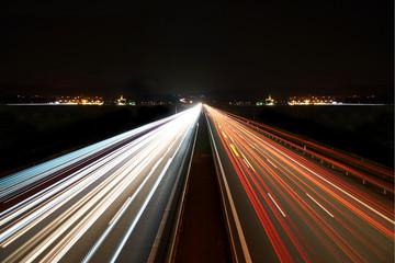 light trails on highway symmetrical