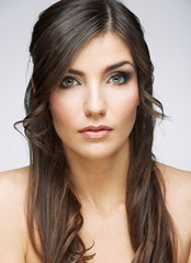 Young beauty woman face close up portrait. Female model with long hair.