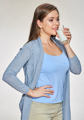 Young woman drink milk. Isolated