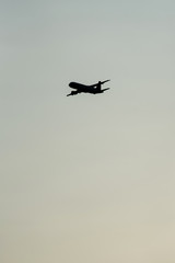 Silhouette of airplane in air