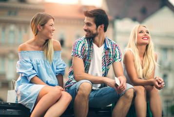Three friends having fun on the bench
