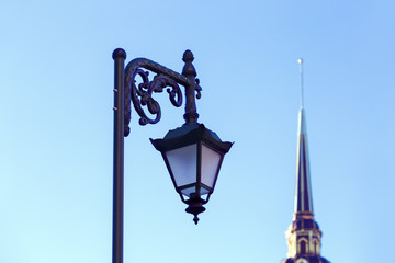 Lantern and steeple of the cathedral against the blue sky