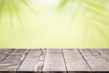Wood table top on blurred background,used for display products