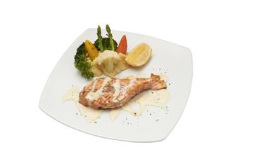 Isolated of Salmon steak with cream sauce.