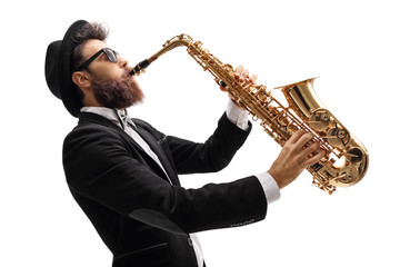Man in a suit playing on a saxophone