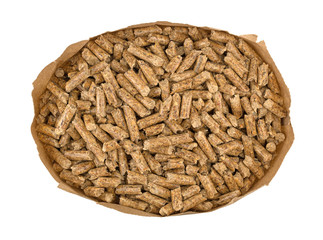 Top view of wood pellets in a brown paper bag isolated on a white background.