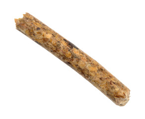 A single wood pellet used for heating isolated on a white background.