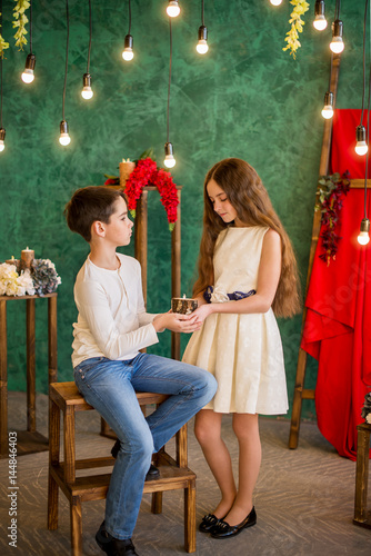 Cute Boy And Girl With Long Hair 12 Years Old Hold A Candle In