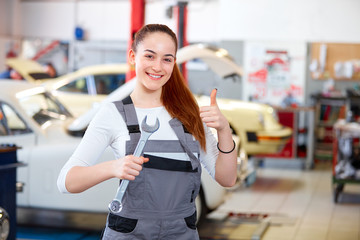 Female mechanic in car service station