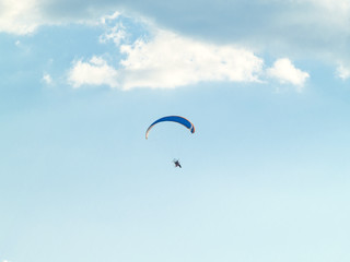A man practicing extreme sport with paraglider with motor