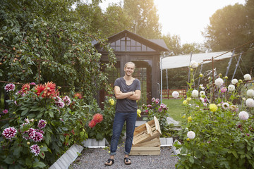 Portrait of man in backyard garden