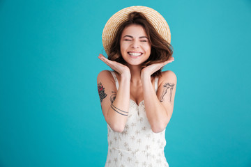 Portrait of a cheerful smiling girl in straw hat Wall mural